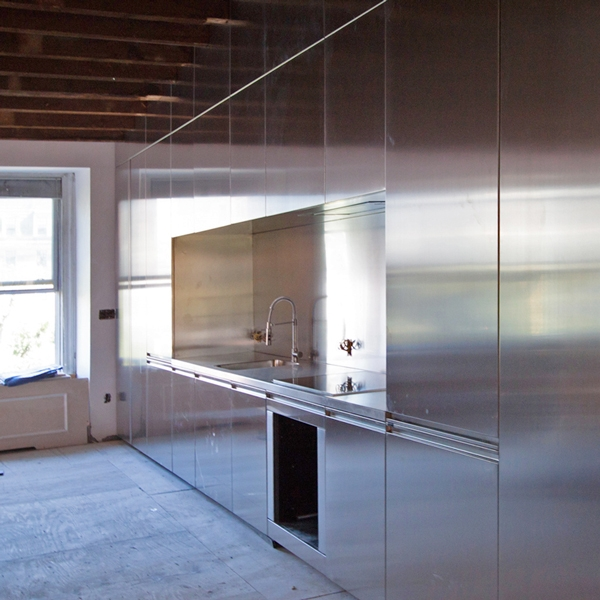 A kitchen entirely steel covered