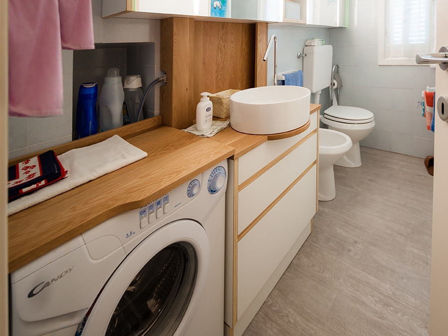 bathroom with washing machine in view